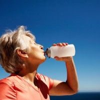 Middle-Aged Woman Drinking Water After Workout