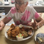 Sampler Platter with Fish and Chips, Clam Strips and Crab Cakes.  It was so much food she took it home.