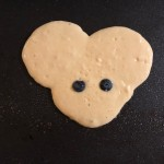 He made Mickey Mouse Pancakes with blueberry eyes!   Ha, ha, ha!  So funny..  They got eaten first.  Everything fresh and made on the spot, so it was hot.