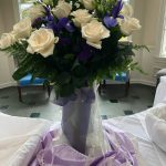 Centerpiece was done in cream, purple, lace and pearls.
