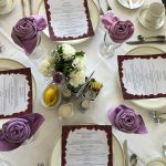 Dining Room Tables.  Centerpieces were white carnations with one single Sterling Silver Rose and baby's breath.  The Lavender linen napkins where folded to resemble a rose.