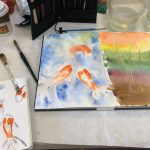 One of our resident artists painting koi fish.