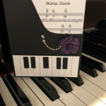 Custom invitation in the shape of a piano - The sheet music is for the song Happy Birthday