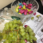 This is taking forever to unwrap the chocolate and wrap a grape in it.
